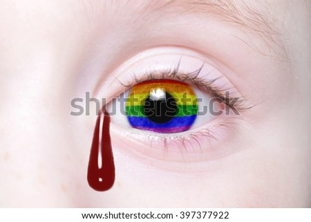 human's eye with gay flag with bloody tears. concept - stock photo