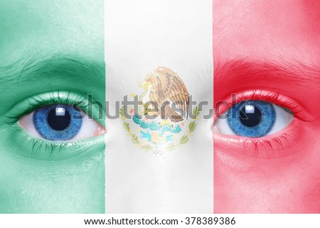 human's face with mexican flag  - stock photo