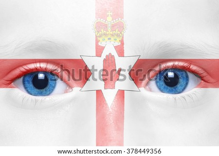 human's face with northern ireland flag  - stock photo