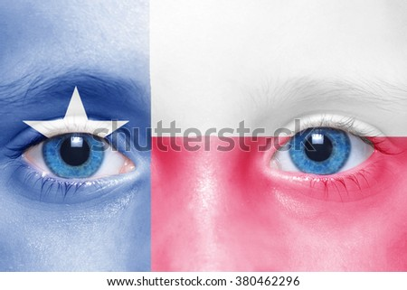 human's face with texas state flag  - stock photo
