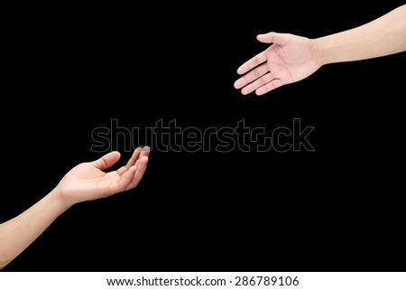 Human's hands help together isolated on black backgrounds.helping hand concept.