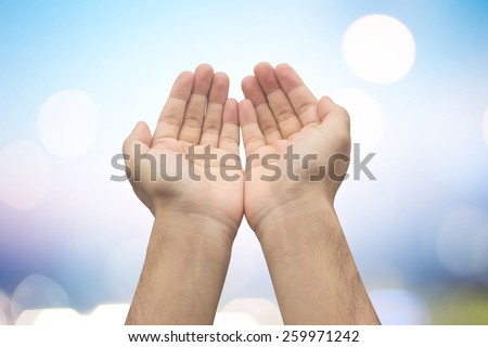 Human's hands pray on blurred light background , soft focused - stock photo