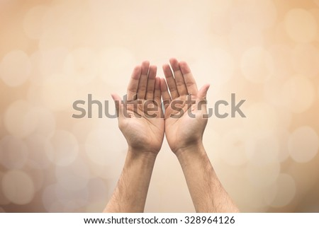 Human's hands pray on blurred nature background , soft focused - stock photo