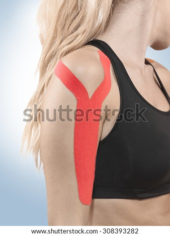 Human shoulder pain with an anatomy injury caused by sports accident or arthritis as a skeletal joint problem medical health care concept. - stock photo