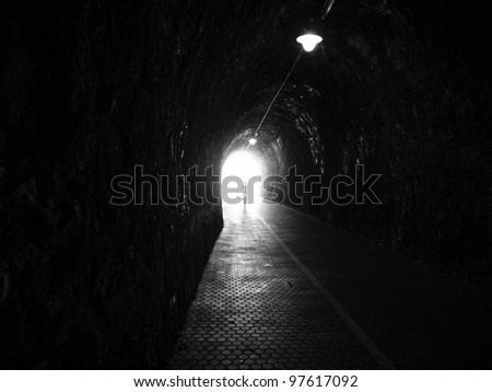 Human silhouette in tunnel, Light at End of Tunnel - stock photo
