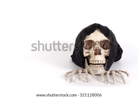 Human Skull and Human Hand with devil black cap isolated on white - stock photo