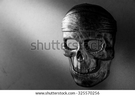 human skull model in black and white style, Halloween background - stock photo