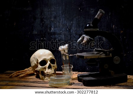 Human skull on old wood background