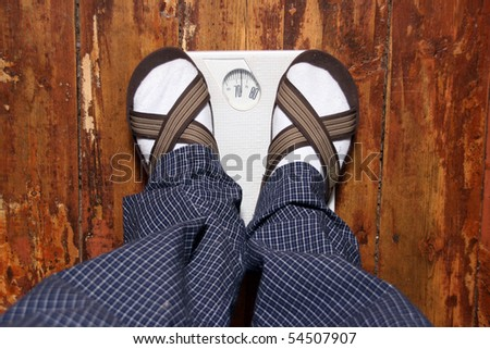 human standing on scales - stock photo