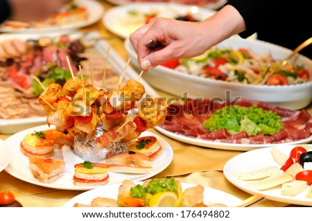 Human taking food on the party  - stock photo
