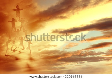 Human team pyramid holding hands in sky - stock photo