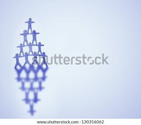 Human team pyramid on blue background - stock photo