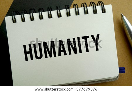 Humanity memo written on a notebook with pen - stock photo