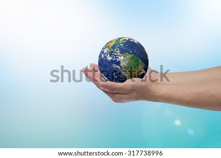 humans hand open palms gesture holding the world over blurred blue sky and sea backgrounds:hands healing globe life concept,ecology concept.clean environment.Elements of this image furnished by NASA - stock photo
