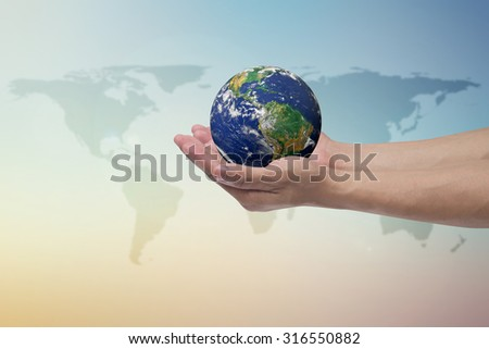 humans hand open palms gesture holding the world over blurred map on pastel sky backgrounds for  healing and safe world life concept.Elements of this image furnished by NASA.