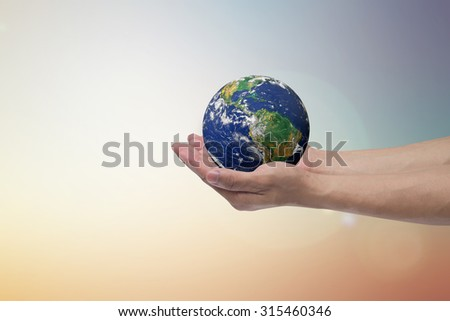 humans hand open palms gesture holding the world over blurred pastel sky backgrounds: human healing world life together concept,saving ecology.environment day.Elements of this image furnished by NASA. - stock photo
