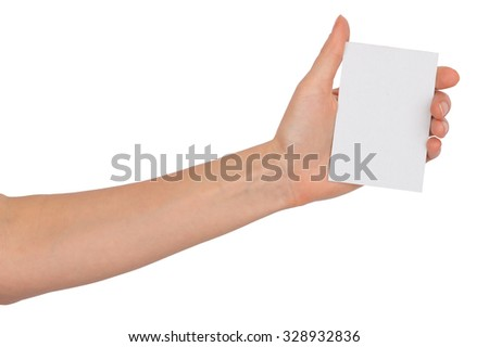 Humans left hand holding small blank card on isolated white background - stock photo