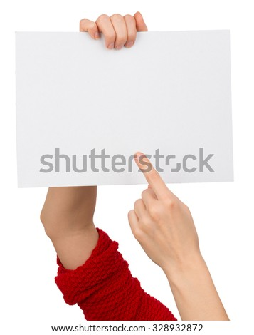 Humans right finger pointing at big blank paper on isolated white background