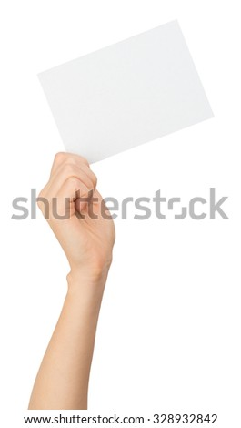 Humans right hand holding small blank card on isolated white background