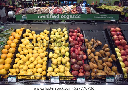 HUMBLE, TEXAS, US - NOV 28, 2016: Certified USDA Organic produces grown by certified organic farmer display at Kroger store. Fresh grape, orange, lemon, Bartlett, Bosc pears and delicious apples.