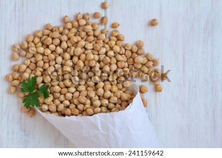 Hummus, chick peas on a vintage wooden background  - stock photo
