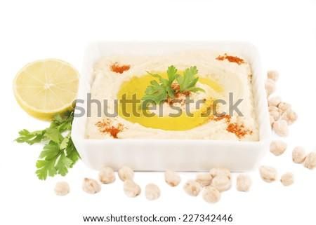 Hummus with lemon on a white background - stock photo