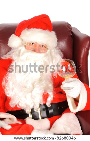 Humorous closeup of Santa Claus (that jolly old elf that  lives at the North Pole) enjoying a drink after a hard days work delivering christmas presents to the children - stock photo