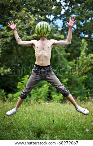 humorous photo of a jumping boy with a watermelon instead of head