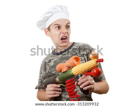 Humorous portrait of a teen boy chef with opened mouth and rifle vegetables, screaming cheers, isolated white background - stock photo