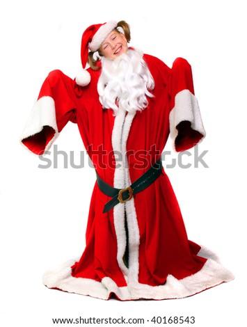 Humorous scene: Little girl in big santas overcoat. Great for Christmas brochures and advertisements - stock photo