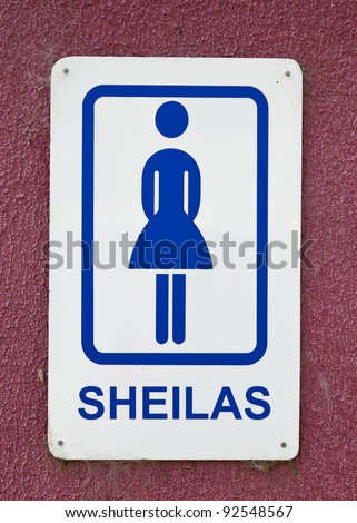 "Humorous sign in Australia using slang for ""females"" on the restroom sign. - stock photo"