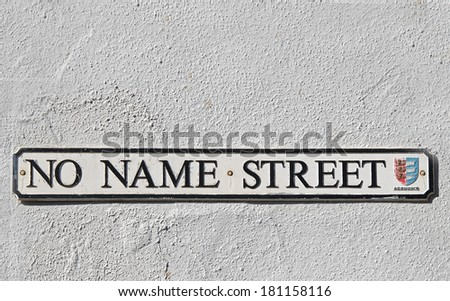 Humorous street sign for No Name Street in Sandwich Kent, England.