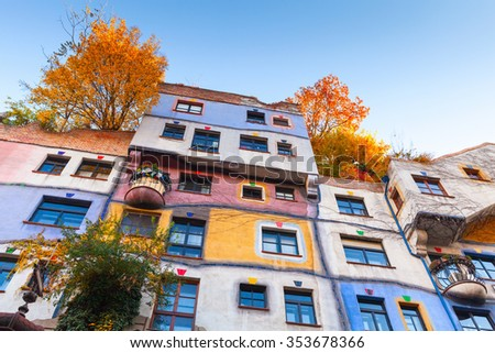 Hundertwasser house, colorful facade with growing trees in Autumn - stock photo