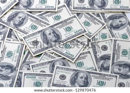 Hundred American dollar bills money pile. - stock photo