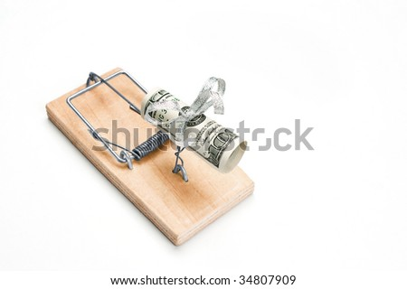 Hundred bucks in a mouse trap is isolated over white background - stock photo