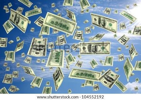 hundred dollar bills flying in the air - stock photo