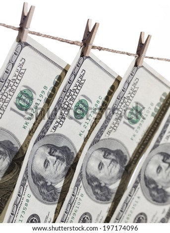 Hundred Dollar Bills Hanging From Clothesline on a White Background. - stock photo