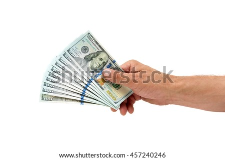 hundred-dollar bills in a man's hand on a white background. horizontal photo.