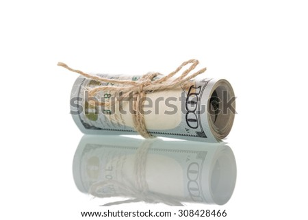 Hundred dollar bills rolled up on white background - stock photo