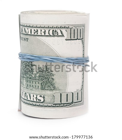 Hundred dollar bills rolled up with rubberband.  - stock photo