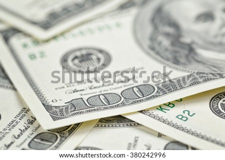 hundred dollars notes background, closeup with shallow focus