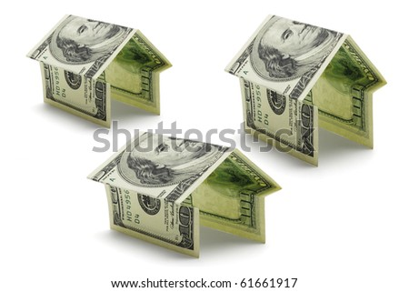 Hundred dollars US notes folded in various shapes and sizes of houses on white background - stock photo