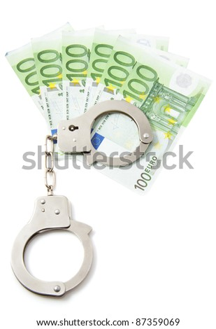 Hundred euro bills with handcuffs over white - stock photo