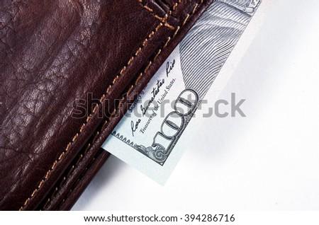 hundred us dollars macro closeup in wallet - stock photo