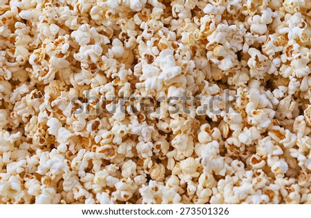 Hundreds of fresh, white, fluffy, popped kernels of corn fill the frame in this closeup view of the popular snack - stock photo