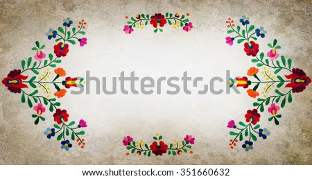 Hungarian embroidery folk frame with grunge background. Folk frame made of handmade embroidery elements.
