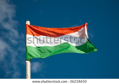 Hungarian flag against blue sky - stock photo