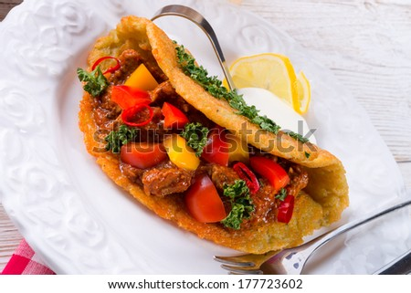 Hungarian goulash with potato pancake