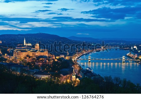 Hungarian landmarks, Chain Bridge and Royal Palace in Budapest by night. - stock photo