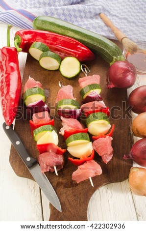 hungarian paprika skewers with pork, red pepper, lilac onion and courgette are prepared - stock photo